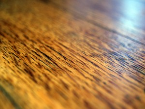 Call a hardwood floor refinishing service for help with your flooring